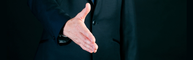 Verbal Lease Agreement - A man holding out his hand to confirm a verbal contract